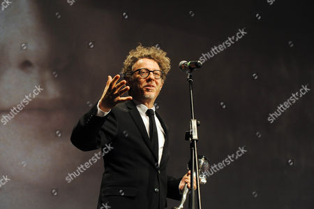 US film director Jeff Preiss delivers a speech as he accepts the Crystal Globe Award for US actress Elle Fanning as best actress in the movie 'Low Down'