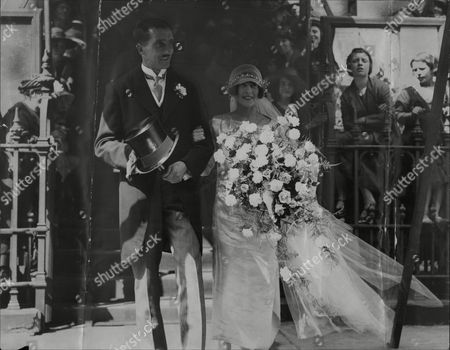 R. Stanley Gledhill And Eleanor Henderson (daughter Of The Home Secretary) Leaving Hinde-street Wesleyan Church After Their Wedding.