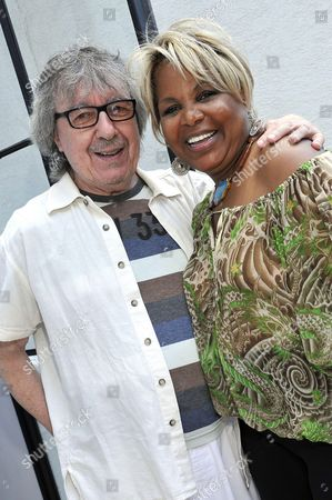 Stock Image of Bill Wyman and Corice Arman