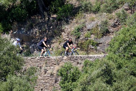 Nicolas Sarkozy and son Jean Sarkozy cycling