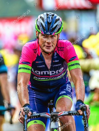 Stock Photo of 42 year old Chris Horner (USA) winner of the Vuelta 2013. 161.5 km: Mulhouse - Planche des Belles Filles