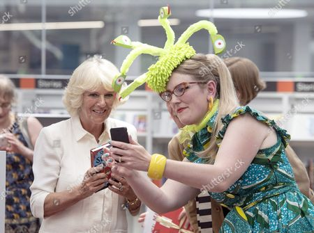Camilla Duchess of Cornwall poses for a 'selfie' with illustrator Sarah McIntyre