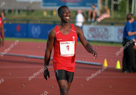 15.07.14 - Welsh Athletics International held at the Cardiff International Sports Stadium - Christian Malcolm thanks the fans after completing his last ever race