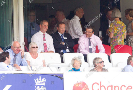 Stuart Lancaster (Left) England Rugby Head Coach), Andy Flower (ex England Cricket Coach) (centre) & Rob Andrew (Professional Rugby Director at the RFU) (Right) watch from the grandstand.