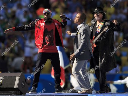 Carlos Santana performs during the closing ceremony with Wyclef Jean and Alexandre Pires