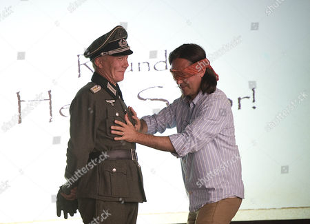 Daily Mail Chalke Valley History Festival 2013. Blindfolded Neil Oliver Feels A Ww2 Nazi Officer During The Histrionics Comedy Quiz.
