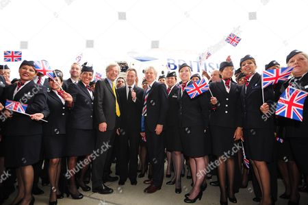 Editorial image of Ba Staff Celebrate Outside The New Arrival Of The A380 As It Parks Up For The First Time Outside The Ba Airbase At Heathrow. Pictured In Centre: (l-r) Keith Williams Ceo Of Ba And Fabrice Bregier President And Ceo Of Airbus Arrive Out From The Airbus