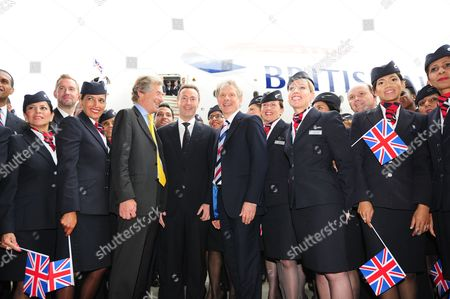 Stock Photo of Ba Staff Celebrate Outside The New Arrival Of The A380 As It Parks Up For The First Time Outside The Ba Airbase At Heathrow. Pictured In Centre: (l-r) Keith Williams Ceo Of Ba And Fabrice Bregier President And Ceo Of Airbus Arrive Out From The Airbus A380 To Join Sir Martin Broughton Chairman Of Ba (right) British Airways Welcomes The Delivery Of Its First Super Jumbo Jet An Airbus A380 At Its Airbase.