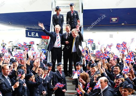 Ba Staff Celebrate Outside The New Arrival Of The A380 As It Parks Up For The First Time Outside The Ba Airbase At Heathrow. Pictured: (l-r) Keith Williams Ceo Of Ba And Fabrice Bregier President And Ceo Of Airbus Arrive Out From The Airbus A380 To Join Sir Martin Broughton Chairman Of Ba (right) British Airways Welcomes The Delivery Of Its First Super Jumbo Jet An Airbus A380 At Its Airbase.