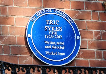 Editorial picture of The Heritage Foundation Unveils A Plaque In Memory Of Eric Sykes Cbe On Orme Court Where He Worked. The Plaque Is Situated Under A Plaque For Spike Milligan On The First Floor Of Number Nine Orme Court.