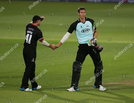 Surrey's Chris Tremlett shanks hands with Somerset Colin Ingram
