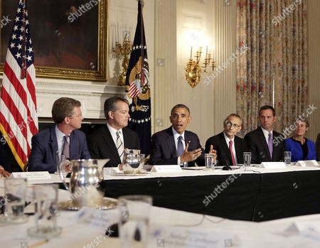 Stock Picture of With Barack Obama are newly confirmed Director of the Office of Management and budget Shaun Donovan (left) David Agnew, White House Director of Intergovernmental Affairs and Deputy Assistant to the President (2nd left), John Podesta, Counselor to the President (4th right), Mike Boots, Acting Chair of the Council on Environmental Quality (2nd right) and Sally Jewell, Secretary of the Interior (right)