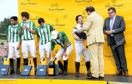Stock Picture of Jo Thornton, Jean-Marc Lacave and winning polo players