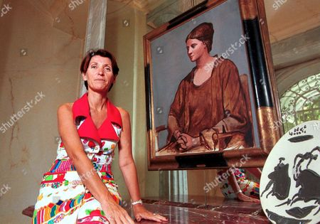 MARINA PICASSO NEXT TO A PORTRAIT OF HER GRANDMOTHER OLGA, PARIS FRANCE - 2002