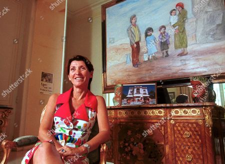 Stock Photo of MARINA PICASSO IN FRONT OF A PAINTING BY HER GRANDFATHER PABLO TITLED 'THE FAMILY', PARIS FRANCE - 2002