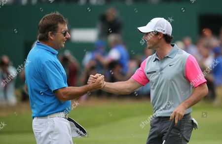 Rory McIlroy is congratulated by his caddie JP Fitzgerald after he wins Open Golf Championship Sunday