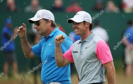 Rory McIlroy celebrates with his caddie JP Fitzgerald after he wins Open Golf Championship Sunday