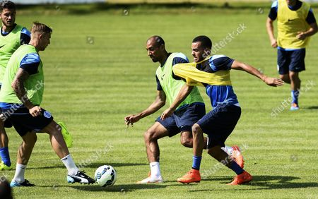 Karl Henry of QPR pulls at teammate Jordan Gibbons as trialist Jack Collison watches on.