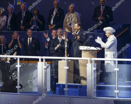Stock Image of Sir Chris Hoy assists Prince Imran of Malaysia, president of the Commonwealth Games Federation, and Queen Elizabeth II