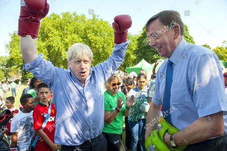 Stock Picture of Mayor of London Boris Johnson boxing with Sir Sir Robin Andrew Wales