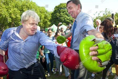 Stock Photo of Mayor of London Boris Johnson boxing with Sir Sir Robin Andrew Wales