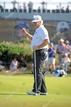 Last years winner Mark Wiebe celebrates his putt on the 13th green