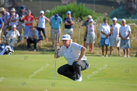 Last years winner Mark Wiebe celebrates lines up his shot 13th green