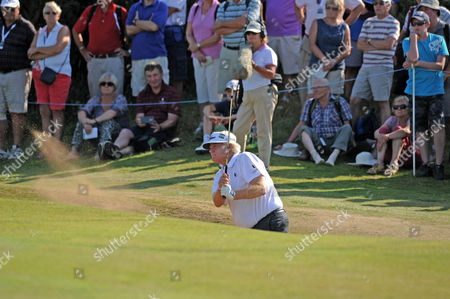 Last years winner Mark Wiebe gets his ball out of the bunker on the 13th green