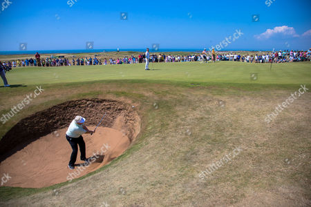 Stock Picture of Mark Wiebe plays out of a bunker on the 15th