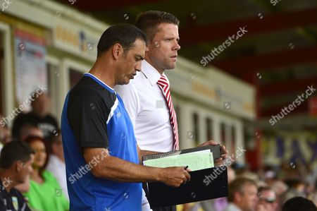Accrington Stanley manager James Beattie with his assistant manager Sir Paul Stephenson