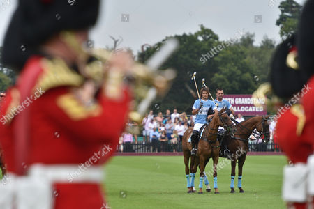 Julio Hernan Ruggeri and Facundo Pieres pictured between the brass band.