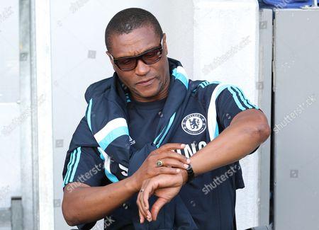 Chelsea FC Technical Director Michael Emenalo checks his watch