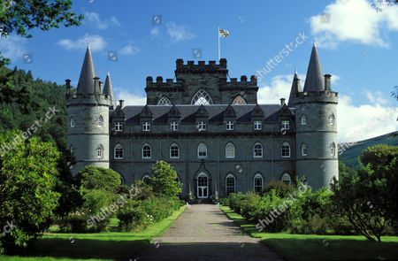 Inveraray Castle, Argyll, Scotland, is the ancestral home of the Duke of Argyll. The castle's construction began in 1720 and is a unique blend of Baroque, Palladian and Gothic architectural styles.