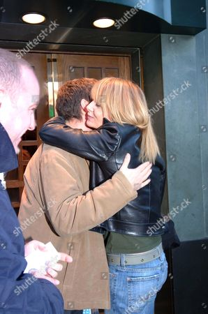 GABY ROSLIN AND NEIL BUCHANAN EMBRACING OUTSIDE THE IVY RESTAURANT