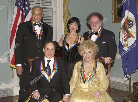 Kennedy Center Honourees, clockwise from lower right, actress Elizabeth Taylor, singer Paul Simon, actor James Earl Jones, actress Chita Rivera, and conductor James Levine.