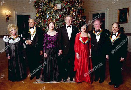 (L to R) Elizabeth Taylor, James Earl Jones, Laura Bush, George W Bush, Chita Rivera, James Levine and Paul Simon
