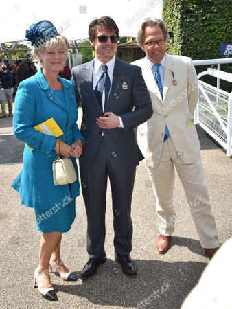 """Tom Cruise arrives at the racecourse with Lord and Lady March as The Band of The Yorkshire Regiment strikes up the theme tune to """"MIssion Impossible"""" on the 3rd day of racing"""