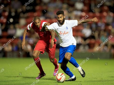 Armand Traore of QPR and Shaun Batt of Leyton Orient