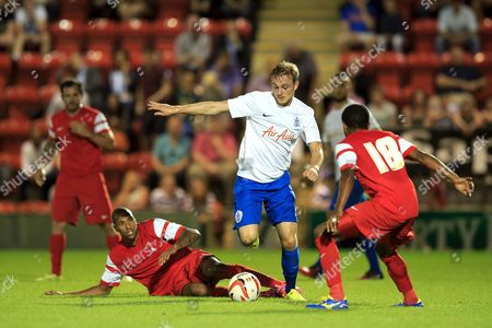 Frankie Sutherland of QPR takes on Bradley Pritchard Shaun Batt of Leyton Orient