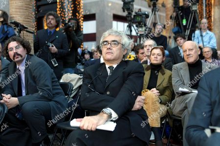 Architects Rafael Vinoly (C), Lord Norman Foster (R) and Greg Lynn (L) listen to fellow architects from another competing team