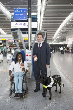 Ade Adepitan and Chris Holmes
