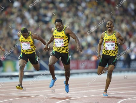 Athletics. Men's 200m final. Rasheed Dwyer wins the gold for Jamaica. 2nd is Warren Weir (right) and 3rd is Jason Livermore (left) all from Jamaica.