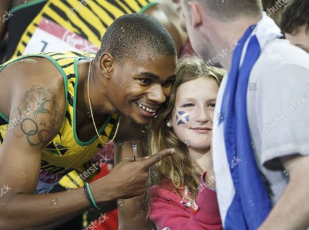 Athletics. 200m Men's final. Warren Weir winner of the silver medal makes a youngsters day taking a 'selfie' with her.