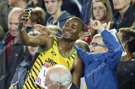 Athletics. 200m Men's final. Warren Weir winner of the silver medal makes a youngsters day taking a 'selfie' with him.