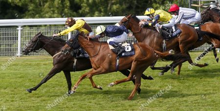 Missunited and Jim Crowley (yellow and brown) winning The Stirling Insurance Lillie Langtry Stakes from Waila (no6) Goodwood
