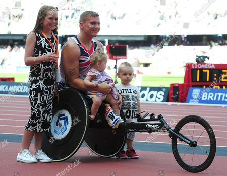 Britain's David Weir After Winning The T54 Mens 1 Mile Pictured Here With His Children After The Race. Ronie 10 Mason 1 And 1/2 And Tilly 9 Months Olympic Stadium London  UK  28/07/2013 London 2013 Para Challenge At The Olympic Stadium Sainsbury's Anniversary Games London.