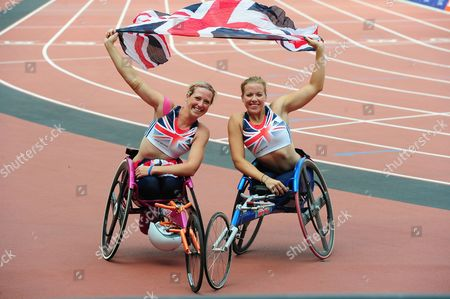 (l-r) Britain's Melissa Nicholls Pictured With Britain's Hannah Cockroft After Cockroft Wins The Womens T33/34 100m Para Challenge At The Olympic Stadium Sainsbury's Anniversary Games London Olympic Stadium London  UK  28/07/2013 London 2013.