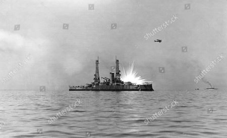 General William 'Billy' Mitchell demonstrates the military potential of American aircraft by sinking the captured German battleship Ostfriesland, considered unsinkable. The ship's sinking July 21, 1921 demonstrated that aircraft could be used effectively against any navy.