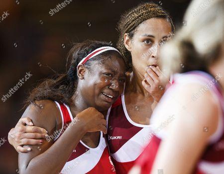 Netball. Women's Semi-Final. New Zealand v England. Kadeen Corbin (left) weeps at the end of the match Geva Mentor tries to comfort her.