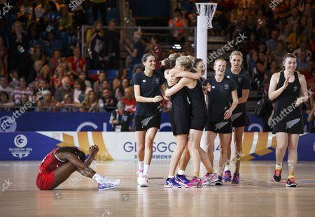 Netball. Women's Semi-Final. New Zealand v England. Kadeen Corbin (left) weeps at the end of the match as New Zealand celebrate their win.